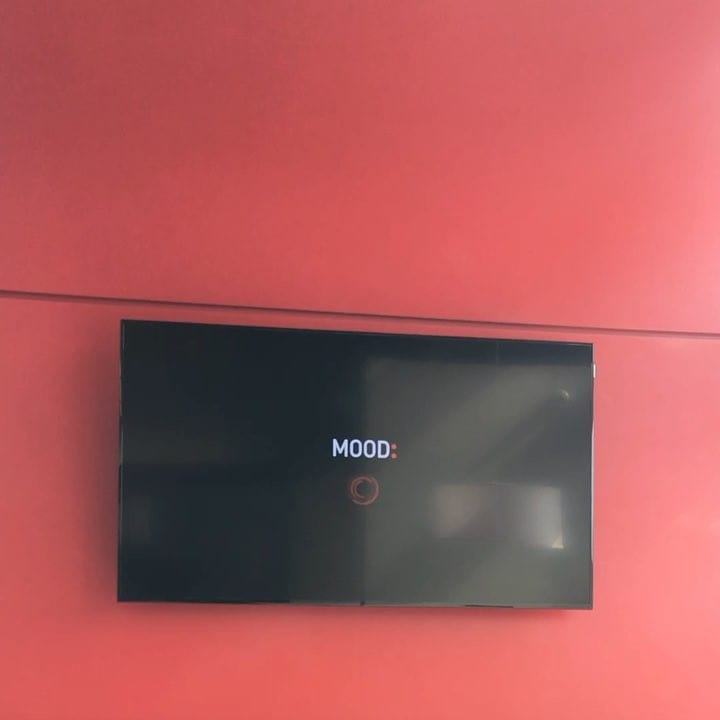 TV screen stuck on a loading screen reading 'MOOD'