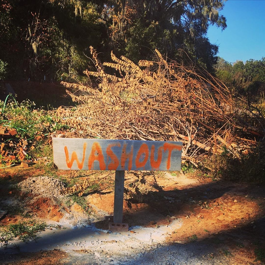 "spray painted sign reading ""washout"""