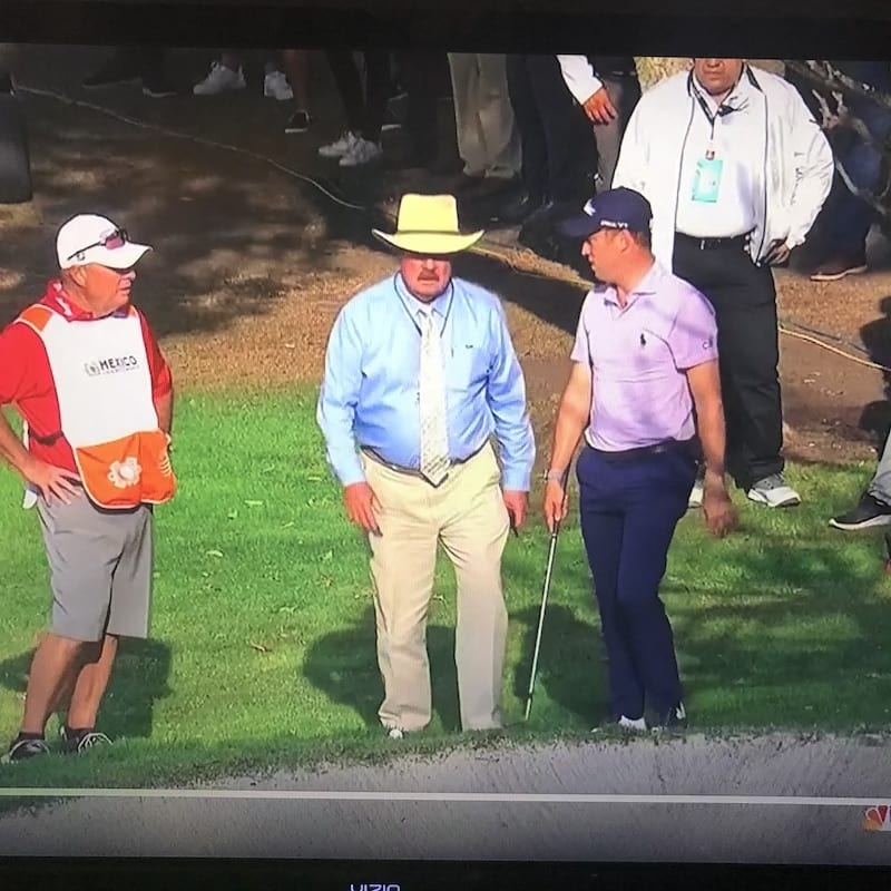 golfer and rules official on TV