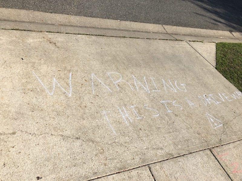 chalk text on a driveway