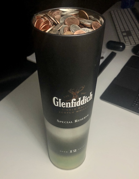a tall can of loose coinage