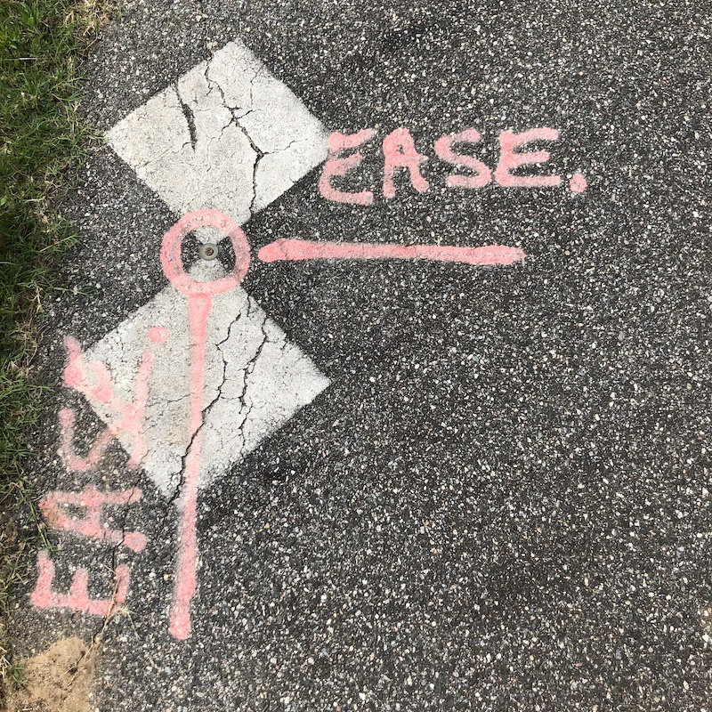 pink paint on asphalt